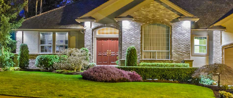 Landscape lighting featuring down-lighting and accent lighting at a home in Northglenn, CO.