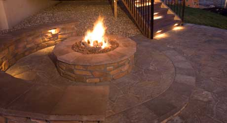 New custom designed fire pit in the backyard of a home in Broomfield.